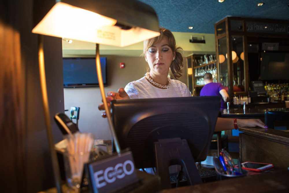 """I am afraid that the character of East Boston is going to be lost,"" Diana Morell, a manager at the swanky martini bar Ecco, said of new development in the neighborhood. (Jesse Costa/WBUR)"