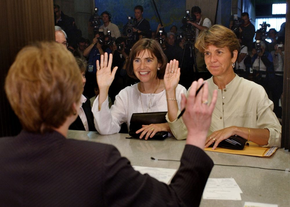 Hillary, right, and Julie Goodridge, left, lead plaintiffs in the Massachusetts gay marriage lawsuit, raise their right hands and affirm that everything on their marriage license is correct while at Boston City Hall in Boston in this Monday May 17, 2004 photo. (Charles Krupa/AP)