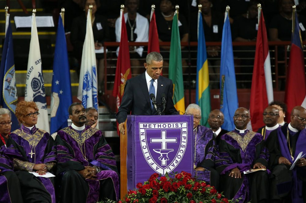 U.S. President Barack Obama delivers the eulogy for South Carolina state senator and Rev. Clementa Pinckney during Pinckney's funeral service June 26, 2015 in Charleston, South Carolina. Suspected shooter Dylann Roof, 21, is accused of killing nine people on June 17th during a prayer meeting in the church, which is one of the nation's oldest black churches in Charleston. (Win McNamee/Getty Images)