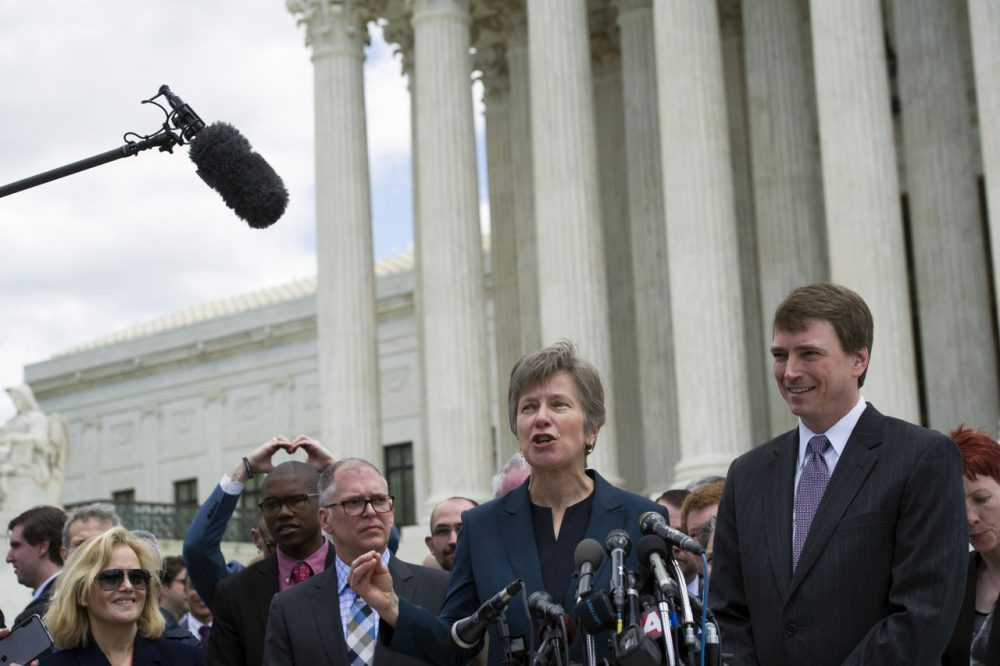 Civil rights lawyer Mary Bonauto, center, flanked by plaintiff James Obergefell of Ohio, left, and Washington attorney Douglas Hallward-Driemeier, right, speaks outside the Supreme Court in Washington, Tuesday , April 28, 2015, following a hearing on same-sex marriage. (Cliff Owen/AP)