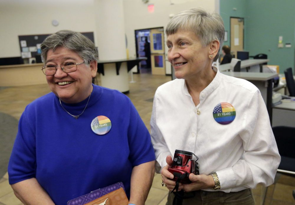 Carmelita Cabello, left, and her partner of 31 years, Jaque Roberts, right, arrive at the Travis County building for a marriage license after hearing the Supreme Court ruling that grants same-sex couples the right to marry nationwide, Friday, June 26, 2015, in Austin, Texas. (Eric Gay/AP)