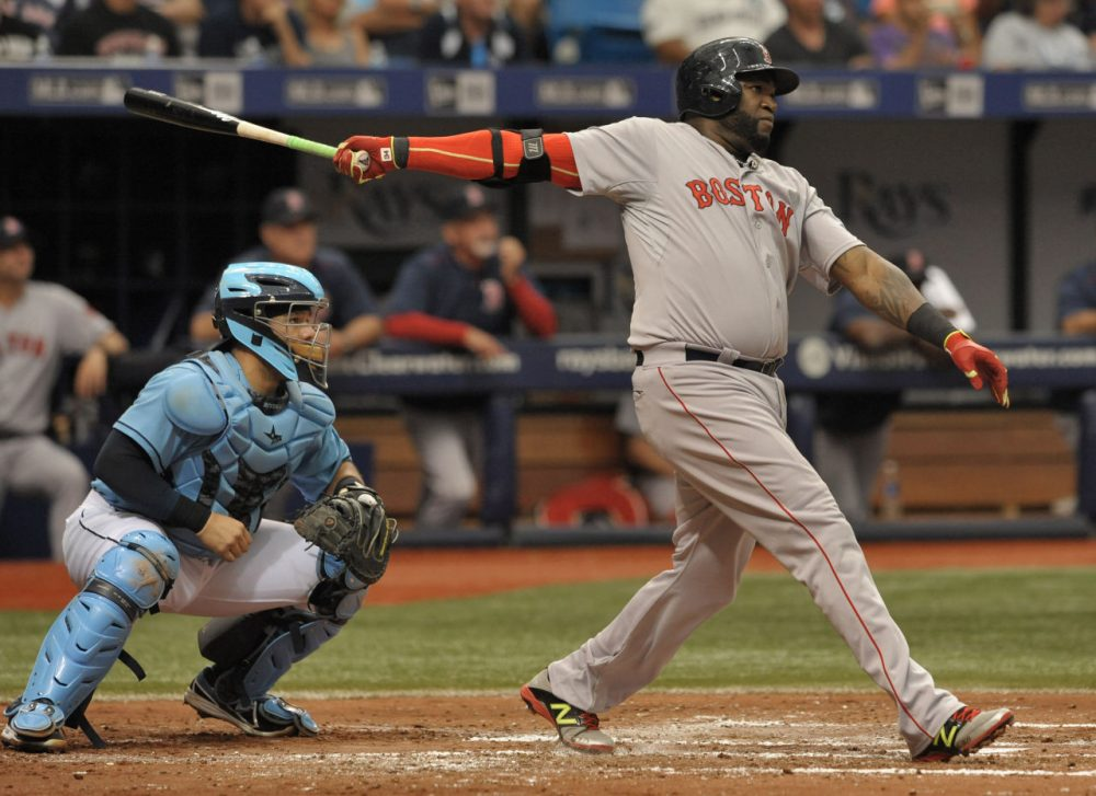 David Ortiz hits a two-run home run during the fourth inning on Sunday. (Steve Nesius/AP)