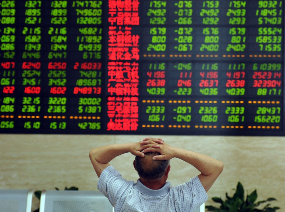 A Chinese stock investor monitors share prices at a securities firm in Fuyang, in China's Anhui province on June 19, 2015.  Shanghai shares plunged 6.42 percent on June 19, ending a torrid week as the benchmark index was hit by tight liquidity and profit-taking after a powerful surge over the past year.    (STR/AFP/Getty Images)