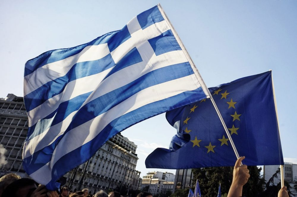 Pro-Euro protesters take part in a rally in front of the Parliament on June 22.  2015 in Athens, Greece. Thousands of people attended the rally in support of Greece remaining in the European Union. Greek banks are closed for six days amid the uncertainty about the bailout deal. (Milos Bicanski/Getty Images)