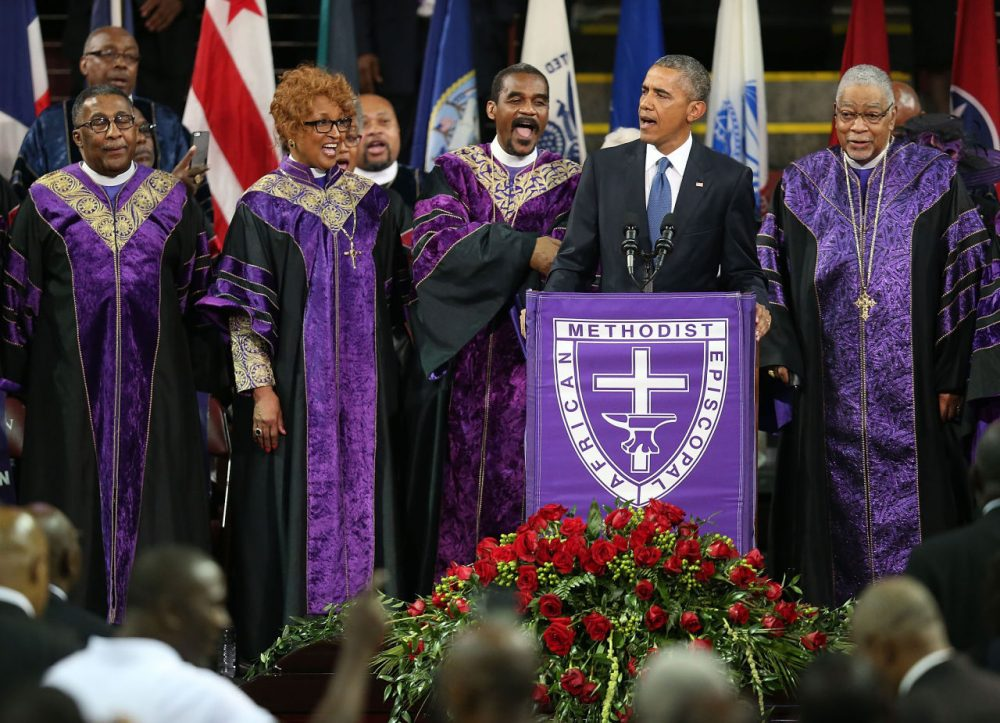 """President Barack Obama sings """"Amazing Grace"""" as he delivers the eulogy for South Carolina state senator and Rev. Clementa Pinckney during Pinckney's funeral service June 26, 2015 in Charleston, South Carolina. (Joe Raedle/Getty Images)"""