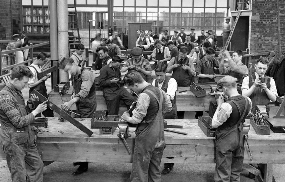 Precision fitters and assemblers at work in the Ministry of Labour Training Centre at Waddon, England on May 19, 1931. Here, in a large factory building, miners from the depressed mining areas all over the country are being trained for entirely new jobs in a scheme which aims to cut unemployment figures. (AP)