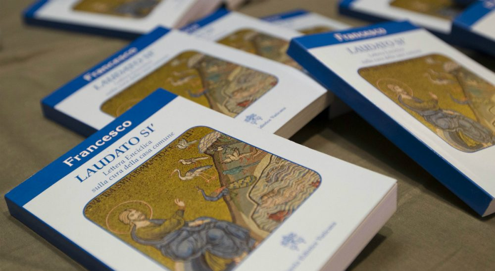 """Copies of Pope Francis' encyclical """"Laudato Si,"""" are displayed prior to the start of a press conference, at the Vatican, Thursday, June 18, 2015. Pope Francis called for a bold cultural revolution to correct what he calls the """"structurally perverse"""" economic system of the rich exploiting the poor that is turning Earth into an """"immense pile of filth.""""(Andrew Medichini/AP)"""