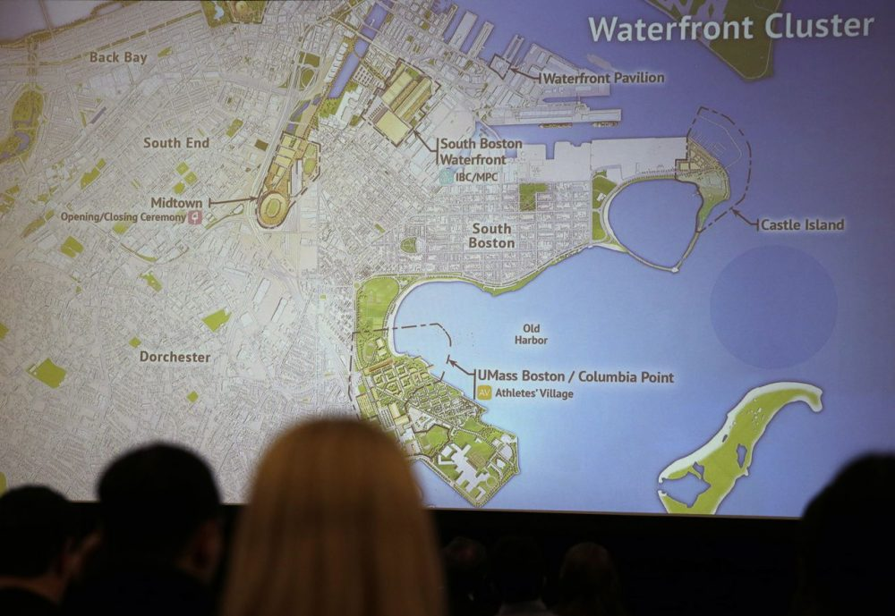 Reporters view a display of possible Olympic venue sites back in January. WBUR's latest poll on hosting the 2024 Summer Games finds support raises substantially under  the scenario of Olympic venues spread across the Bay State, rather than clustered around Greater Boston. (Charles Krupa/AP)