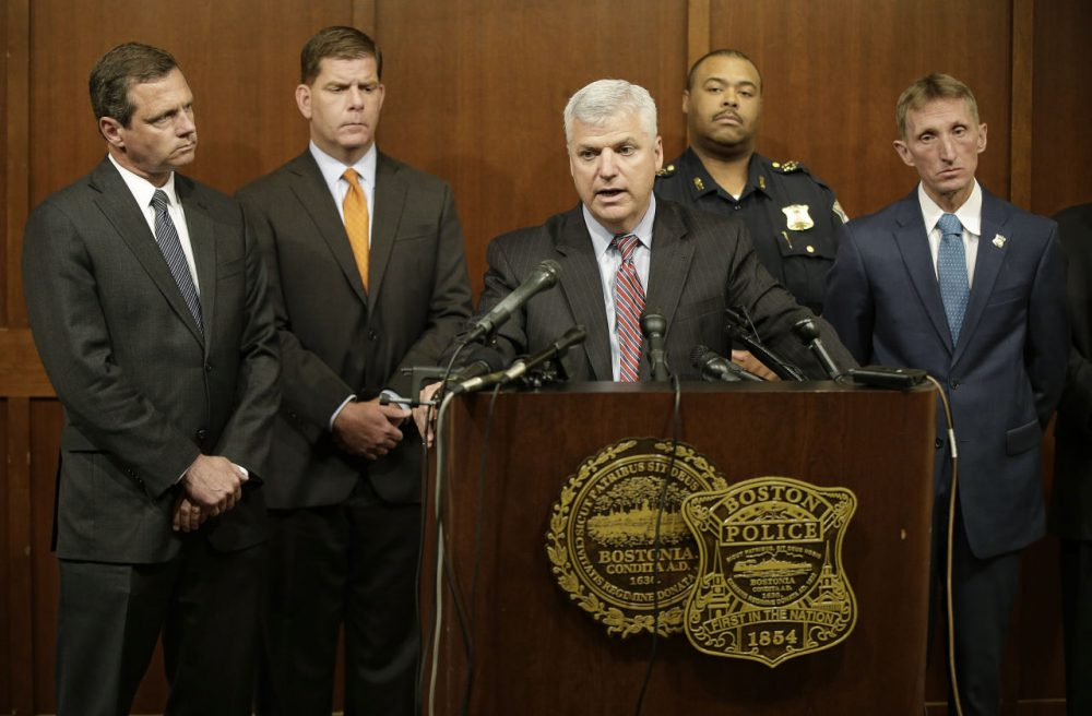 Suffolk County District Attorney Daniel F. Conley speaks as FBI Special Agent in Charge of Boston Vincent B. Lisi, left to right, Boston Mayor Marty Walsh and Boston Police Commissioner William B. Evans, far right, look on during a joint news conference at the Boston Police Department's Headquarters Tuesday, June 2, 2015, in Boston. A man under surveillance by a joint terrorism task force was shot and killed outside a pharmacy Tuesday after he lunged with a knife at a city police officer when asked to drop his military style knife before the officer and an FBI agent opened fire. (AP Photo/Stephan Savoia)