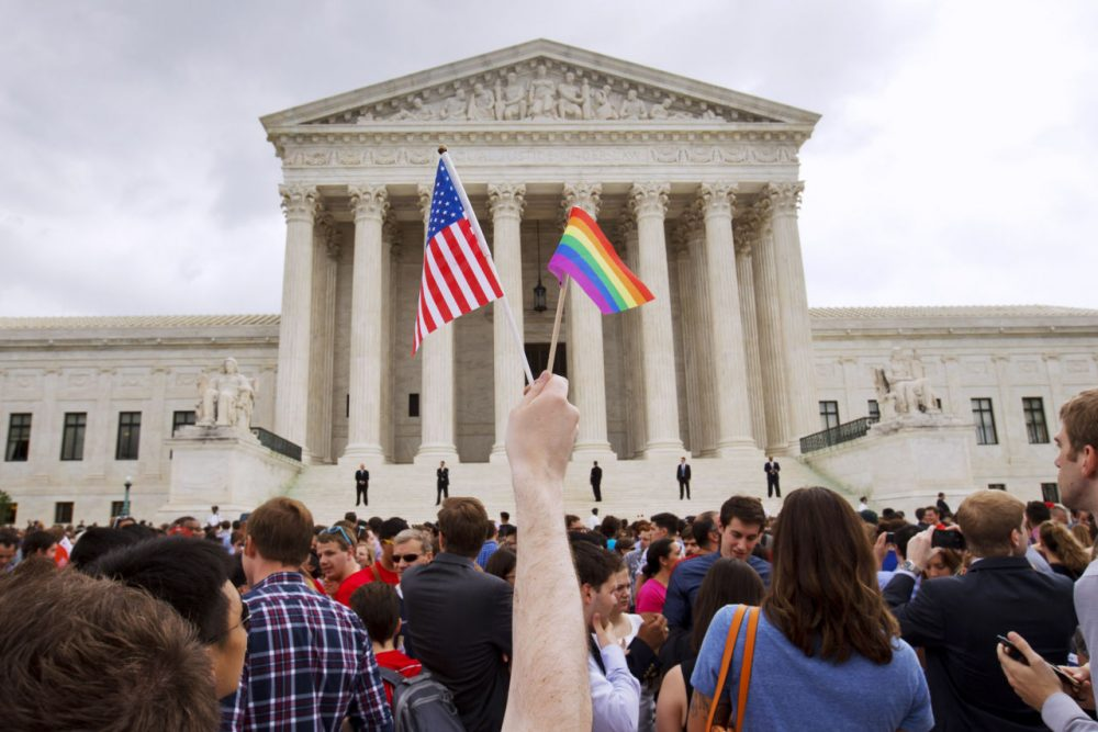 A crowd celebrates outside of the U.S. Supreme Court Friday after the court declared that same-sex couples have a right to marry anywhere in the U.S. (Jacquelyn Martin/AP)