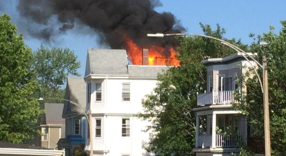 A house is on fire. Do you rush to warn residents who might still be inside, or do you stop to take a picture? (Judith Harris/Courtesy)