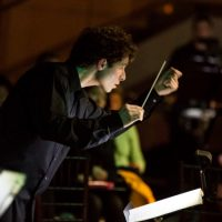 Composer Matthew Aucoin conducting at Peabody Essex Museum. (John Andrews/Peabody Essex Museum)
