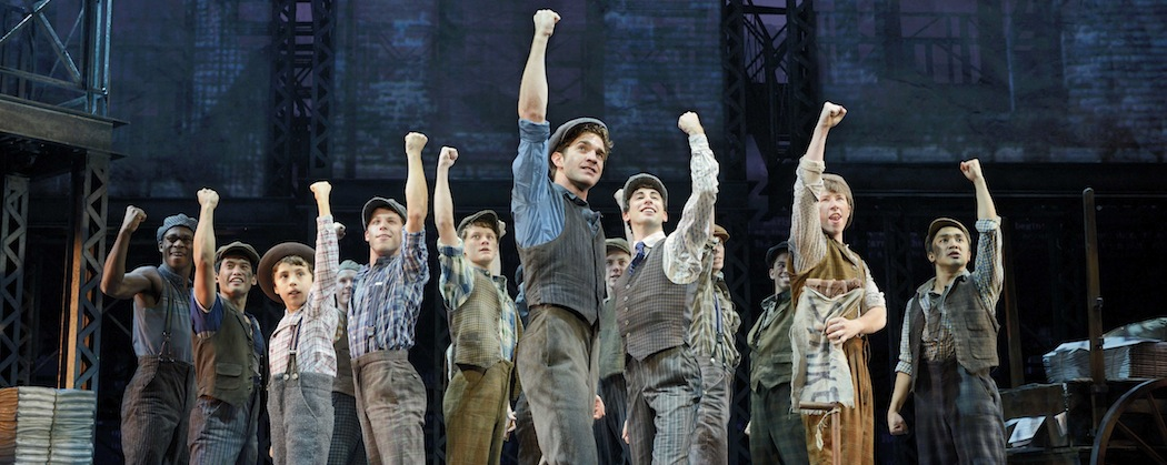 """Dan DeLuca (center) and the ensemble of Disney's """"Newsies,"""" which at times almost suggests a """"Les Misérables"""" for the American urchin set.  (Deen van Meer/Disney)"""