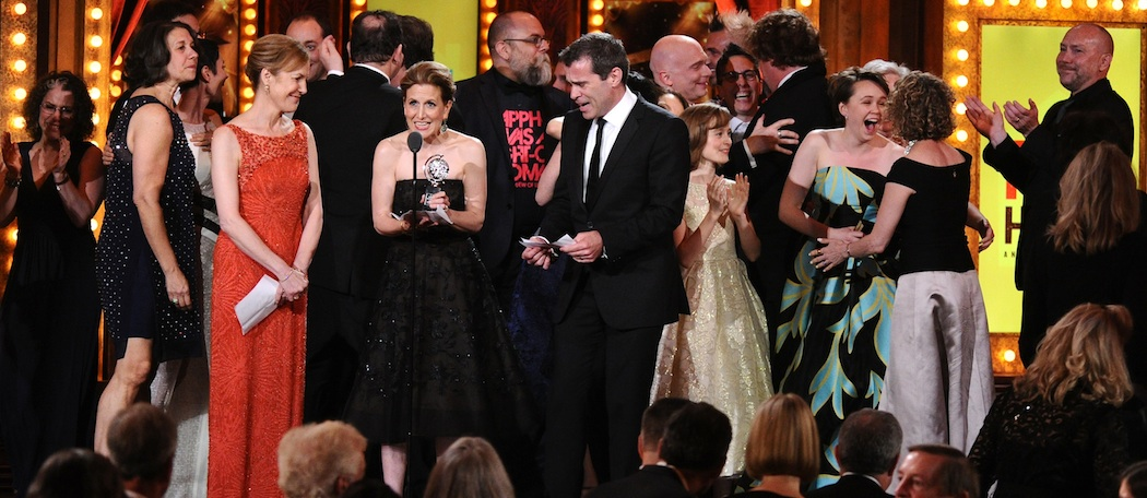 "Kristin Caskey, center, along with a cast and crew accepts the award for best musical for ""Fun Home""at the 69th annual Tony Awards at Radio City Music Hall on Sunday. (Charles Sykes/Invision/AP)"