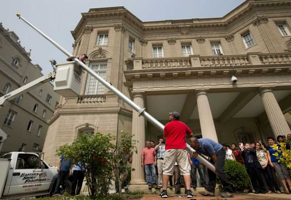 Workers from Eastern Shores Flagpoles raise a flagpole at the Cuban Interest Section in Washington in preparation for re-opening of embassies in Havana and Washington, Wednesday, June 10, 2015. (Pablo Martinez Monsivais/AP)
