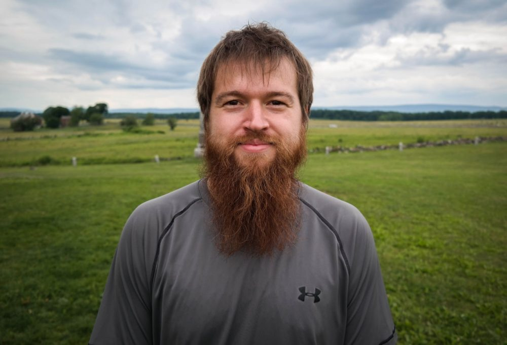 Kyle Beger, 28, of St. Joseph, Missouri, visits The Angle at the Gettysburg battlefield, June 17, 2015. The site marks the place where Confederate soldiers briefly broke the Union line during Pickett's Charge on the third day of the battle. (Lou Blouin)