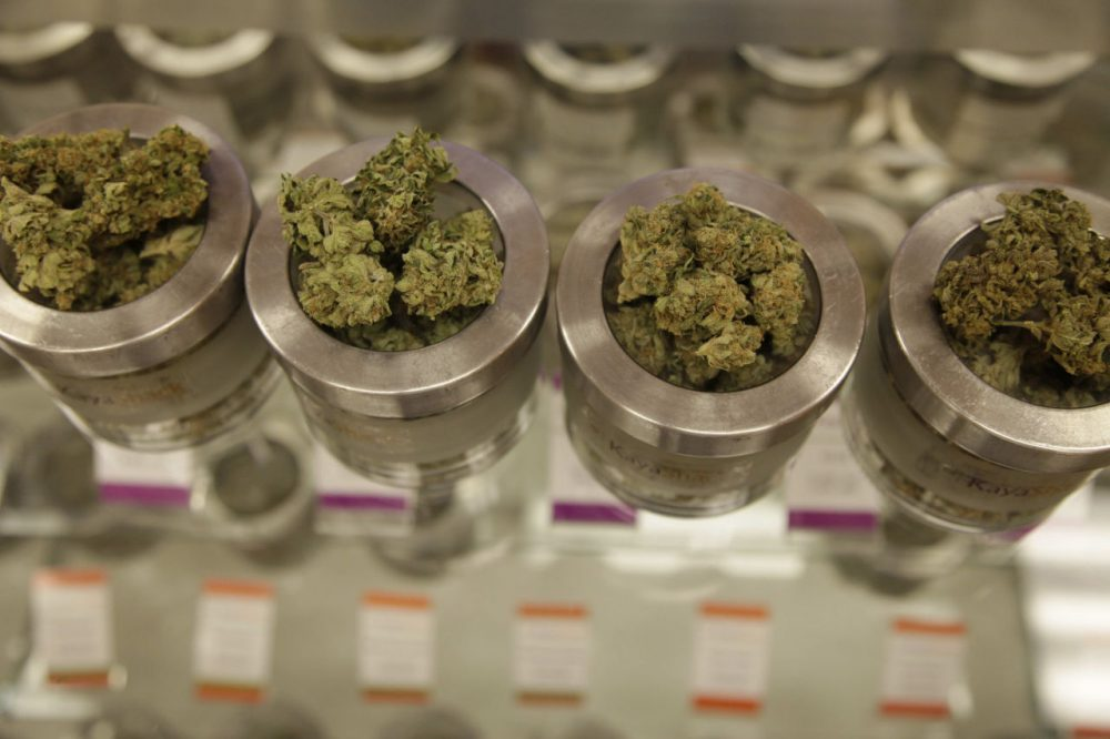 Different varieties of marijuana flowers are displayed at medical marijuana dispensary Kaya Shack in Portland, Ore. On July 1, recreational marijuana in Oregon became legal, but it's likely customers won't be able to buy the pot at medical dispensaries until October 1. (Gosia Wozniacka/AP)