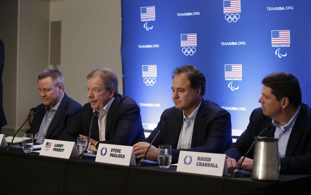 From left: United States Olympic Committee CEO Scott Blackmun, USOC Chair Larry Probst, Boston 2024 Chair Steve Pagliuca and Boston 2024 Vice Chair Roger Crandall speak during a news conference Tuesday in Redwood City, Calif. (Eric Risberg/AP)