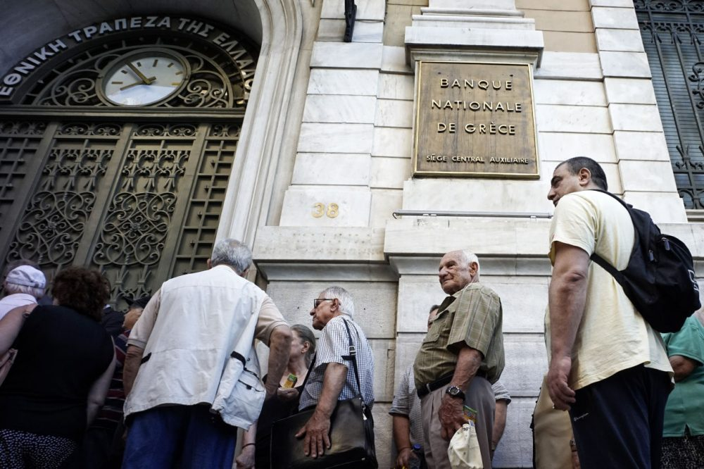 Pensioners line up outside a National Bank branch on July 2, 2015 in Athens, Greece. As people continue to queue outside banks Greek finance minister Yanis Varoufakis said that he will quit if voters don't back him up in Sunday's referendum. (Milos Bicanski/Getty Images)