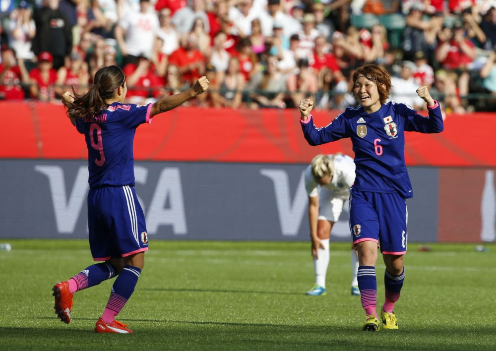 Nahomi Kawasumi #9 and Mizuho Sakaguchi #6 of Japan celebrate after Laura Bassett #6 of England scored on her own team in the final minutes of the game during the FIFA Women's World Cup Canada Semi Final match between England and Japan at Commonwealth Stadium on July 1, 2015 in Edmonton, Alberta, Canada. (Todd Korol/Getty Images)