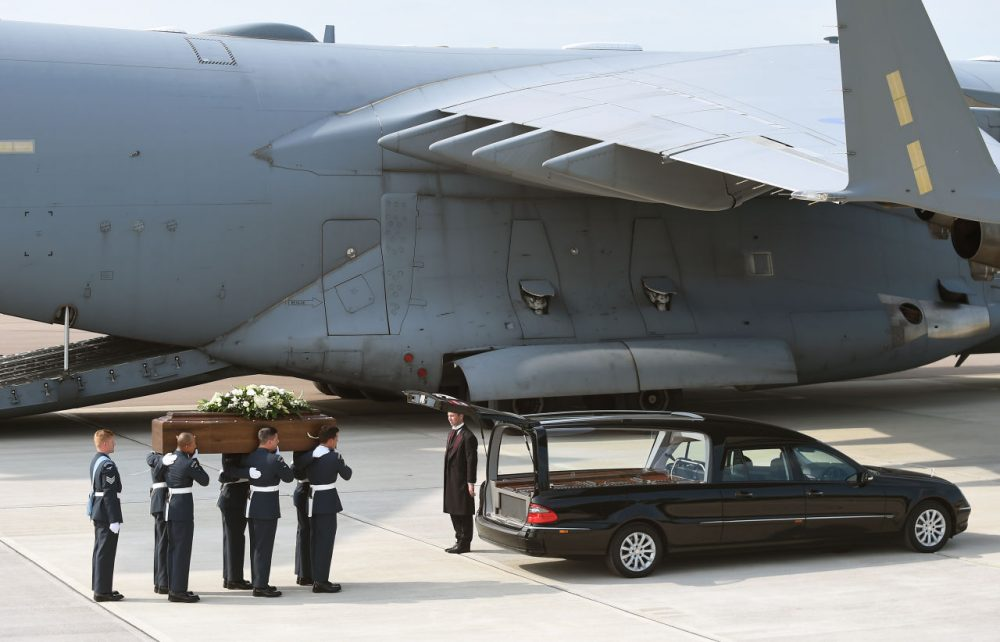 The coffin of Elaine Thwaites, one of the victims of last Friday's terrorist attack, is taken from the RAF C-17 aircraft at RAF Brize Norton in Tunisia, on July 1, 2015 in Brize Norton, England. (Joe Giddens/WPA Pool/Getty Images)