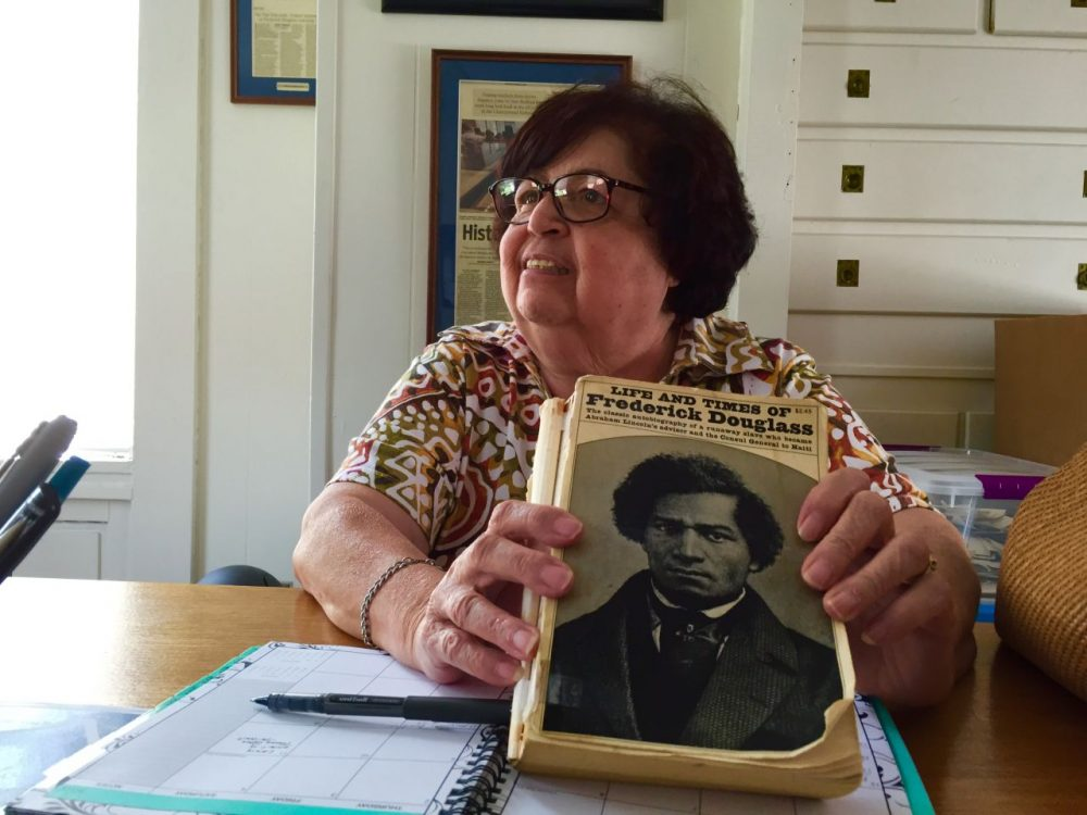 """Dawn Blake Souza, a retired educator in New Bedford, is reading """"The Life and Times of Frederick Douglass"""" for the fourth time. (Simón Rios/WBUR)"""