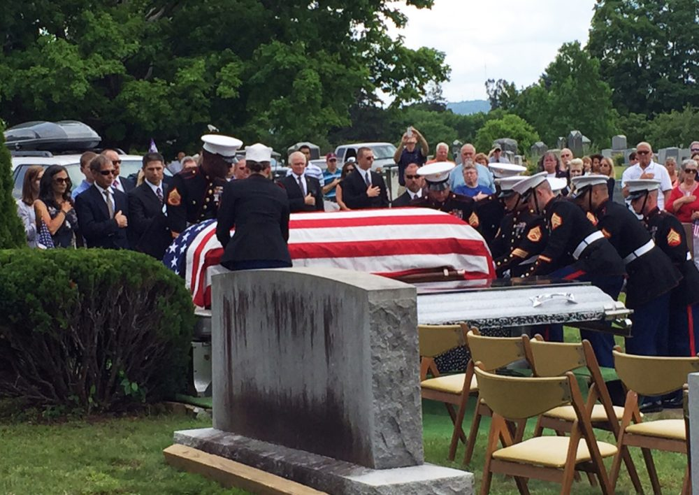 Family and servicemen gather at the burial service for a World War II Marine in his hometown. (David Boeri/WBUR)