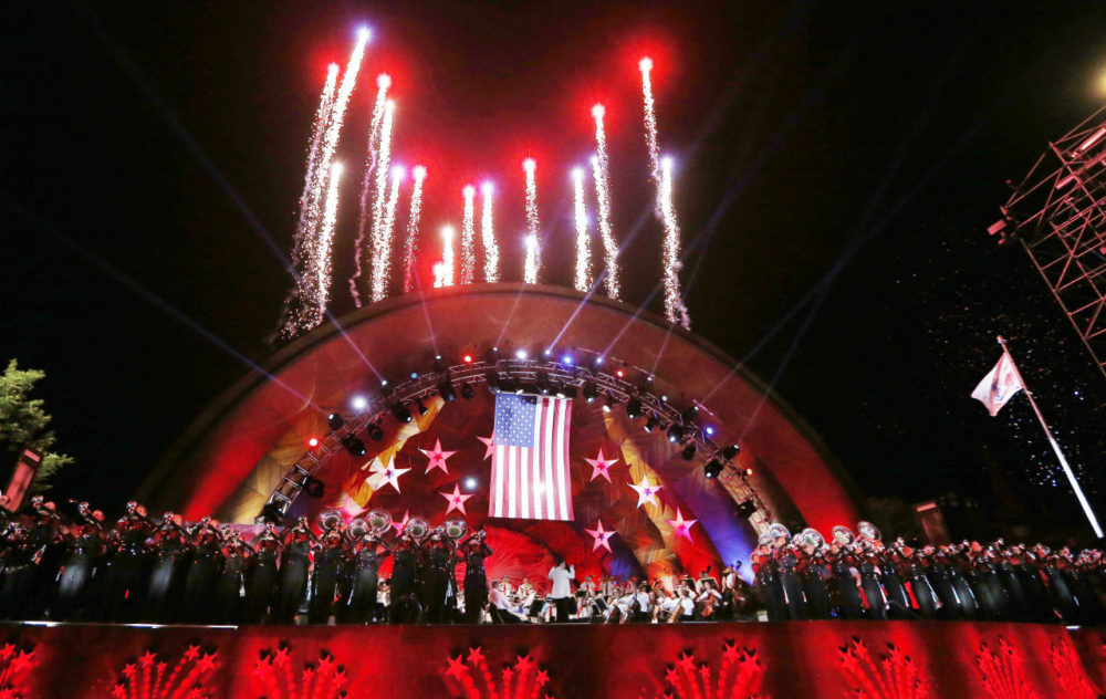 Fireworks shoot from the top of the Hatch Shell during rehearsal for the annual Boston Pops orchestra Fourth of July concert in Boston, Friday, July 3, 2015. (Michael Dwyer/AP)