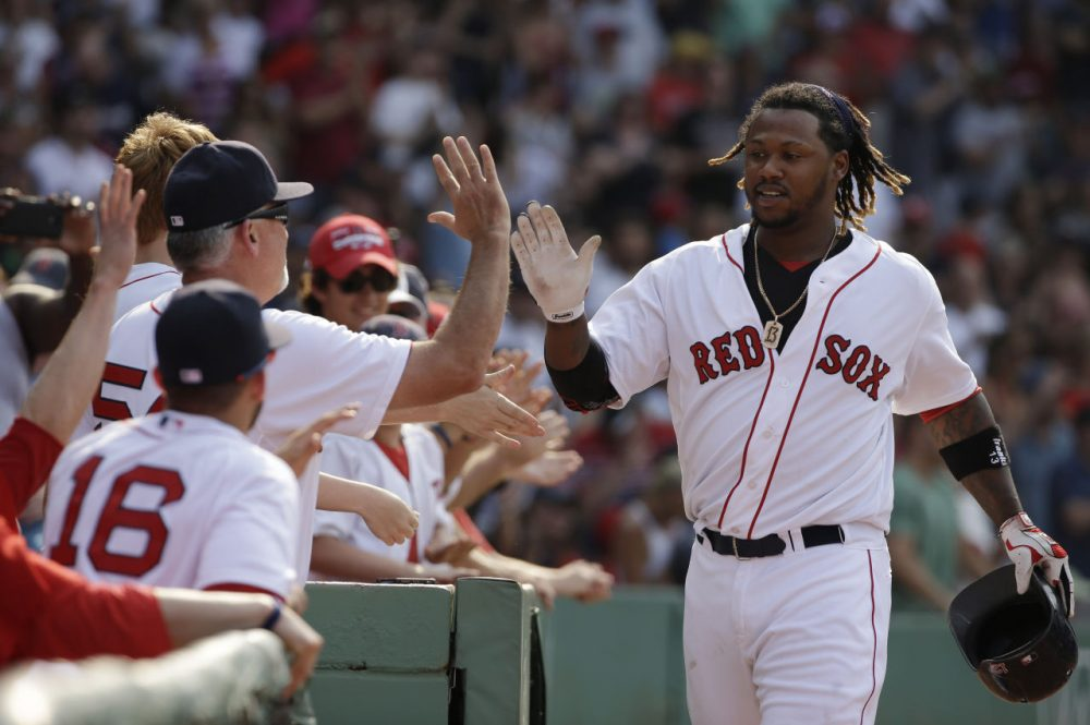 The Red Sox's Hanley Ramirez is welcomed to the dugout after hitting a two-run homer in the seventh inning of a game against the Houston Astros at Fenway Park on Sunday.  (Steven Senne/AP)