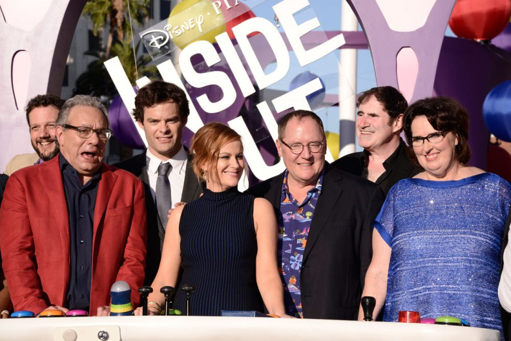 "Michael Giacchino, and from left, Lewis Black, Bill Hader, Amy Poehler, John Lasseter, Richard Kind and Phyllis Smith at the Los Angeles premiere of  ""Inside Out"" at the El Capitan Theatre June 8. (Dan Steinberg/Invision/AP)"