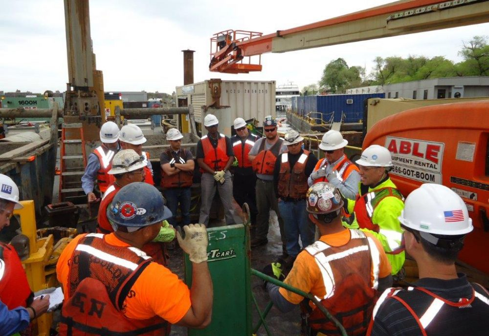 Rich Cavallaro (on right, in yellow) talks with a group of construction workers during Safety Week in May. (Courtesy)