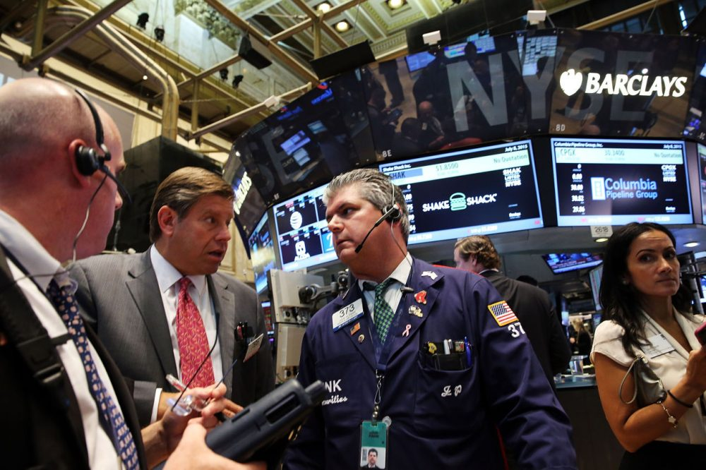 """Traders wait for trading to resume on the floor of the New York Stock Exchange (NYSE) after trading was halted due to a """"technical glitch"""" on July 8, 2015 in New York City. Trading was to resume in the afternoon. (Spencer Platt/Getty Images)"""