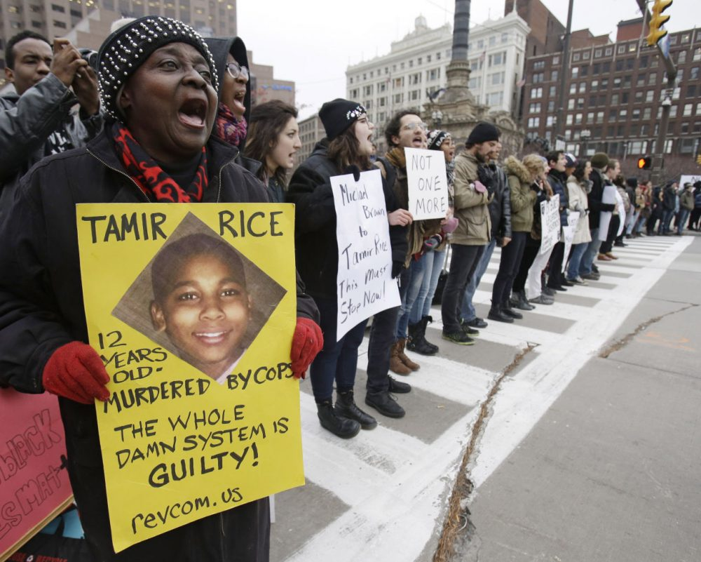 Demonstrators block Public Square in Cleveland, during a protest over the police shooting of 12-year-old Tamir Rice. A judge has ruled that evidence exists to charge two police officers in the fatal shooting of a 12-year-old boy who was holding a pellet gun outside a recreation center June 11, 2015. (Tony Dejak/AP)