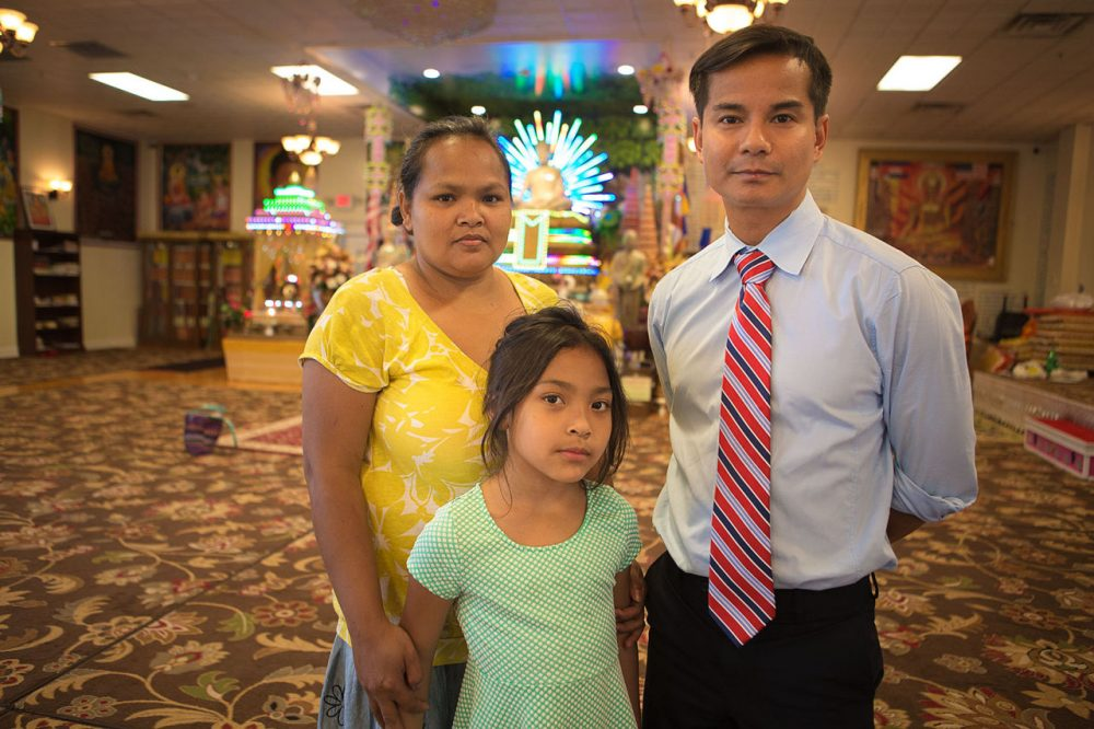Lowell fire survivors Kim Soeun, left, and her daughter, and Virk Uy, of the Cambodian Mutual Assistance Association. (Jesse Costa/WBUR)