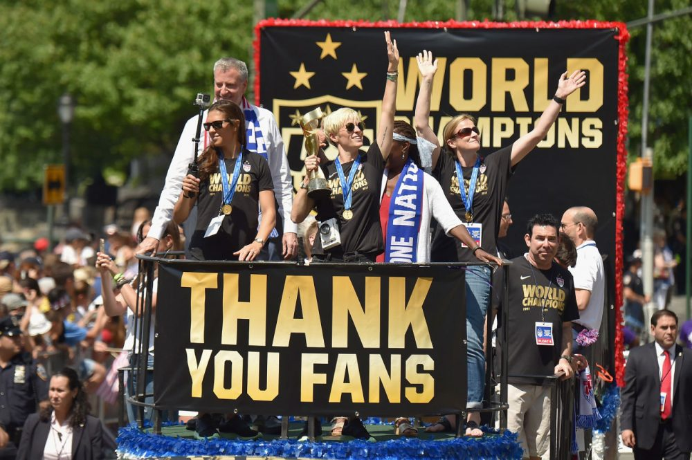 Soccer players Carli Lloyd and Megan Rapinoe in the New York City Ticker Tape Parade for World Cup Champions U.S. Women's Soccer National Team on July 10, 2015 in New York City. (Michael Loccisano/Getty Images)