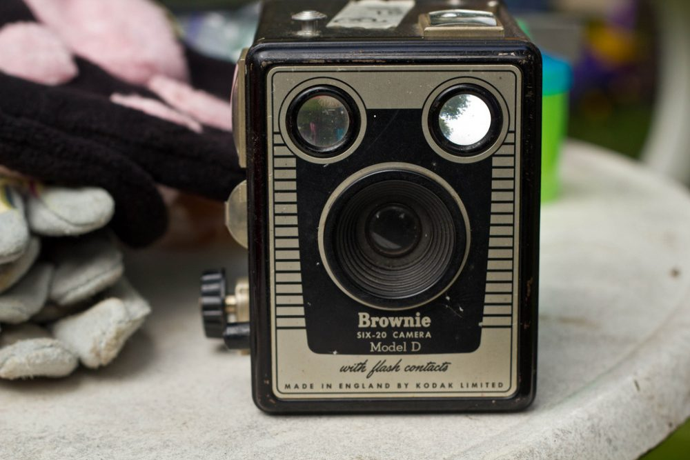 Kodak's Brownie camera, introduced in 1900, made photography accessible to the masses because it was a point-and-shoot, compact and simply designed technology, similarly to cell phone cameras today. (janellie23/Flickr)