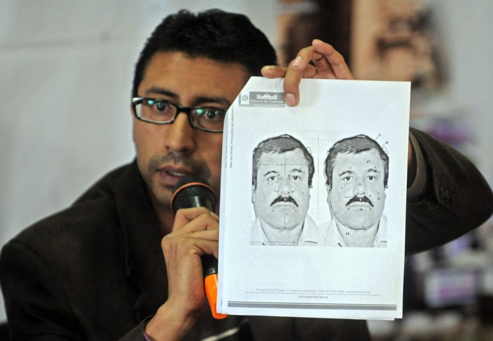 "Guatemalan migration director Carlos Pac shows a picture of Mexican drug trafficker Joaquin ""El Chapo"" Guzman Loera during a press conference in Guatemala City on July 12, 2015. The security authorities of Guatemala are in alert after the escape of the leader of the powerful Sinaloa cartel, reported Sunday an official source. AFP PHOTO / Johan ORDONEZ        (Photo credit should read JOHAN ORDONEZ/AFP/Getty Images)"