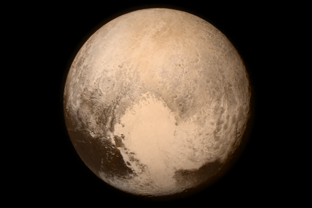 A view of Pluto from the Long Range Reconnaissance Imager (LORRI) aboard NASA's New Horizons spacecraft taken on July 13, 2015 when the spacecraft was 476,000 miles from the surface. This is the last and most detailed image sent to Earth before the spacecraft's closest approach to Pluto on July 14. (NASA/JHUAPL/SWRI)