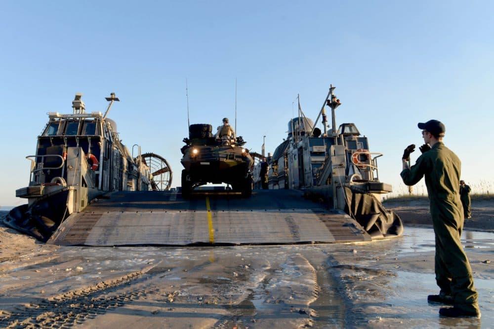 Marines unloading a light armored vehicle off a landing craft at Camp Lejeune, North Carolina. (U.S. Navy)