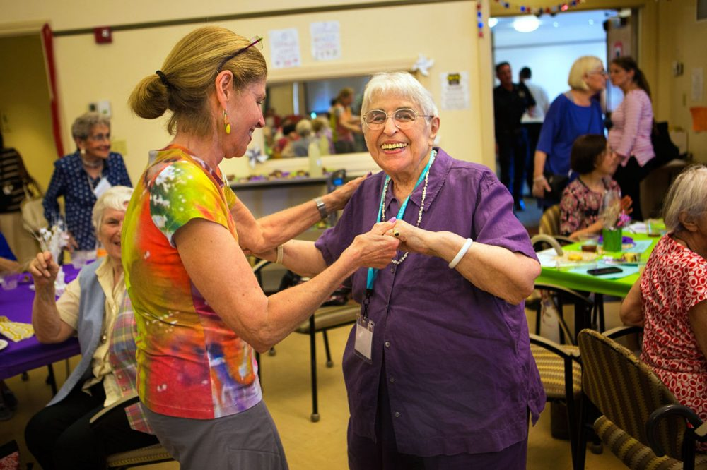 "Ethel Weiss, 100, dances with her daughter Anita Jamieson at the ""Party Of The Century"" at the Brookline Senior Center. (Jesse Costa/WBUR)"