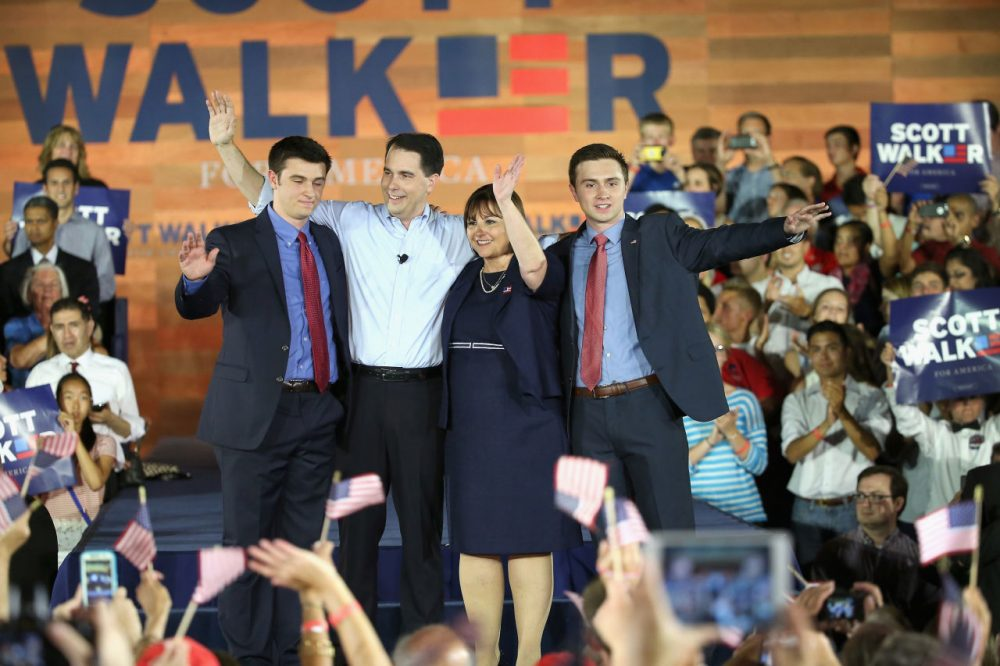 Wisconsin Governor Scott Walker stands on stage with his wife Tonette and sons Alex (L) and Matt afer announcing that he will seek the Republican nomination for president on July 13, 2015 in Waukesha, Wisconsin. (Scott Olson/Getty Images)