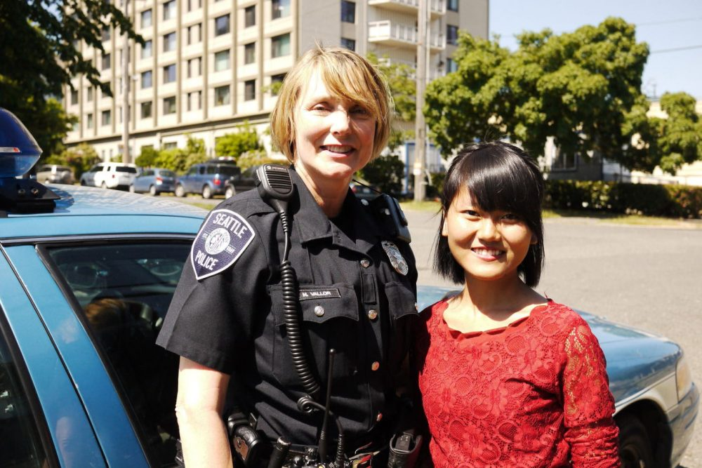 Officer Michelle Vallor and community leader Vung It. (Liz Jones/KUOW)