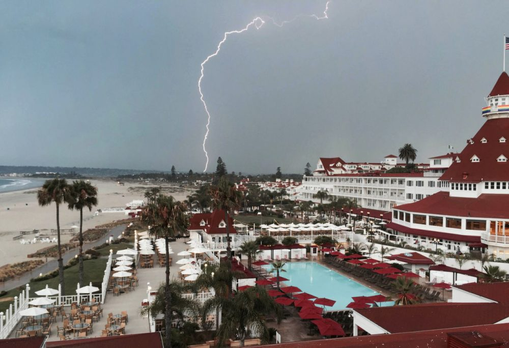 In this Saturday, July 18, 2015, photo provided by Brook Taylor, a lightning storm is captured from the Hotel Del Coronado in San Diego, Calif. A second day of showers and thunderstorms in southern and central California on Sunday was expected to bring heavy rain and set more rainfall records in what is usually a dry month. (Brook Taylor via AP)