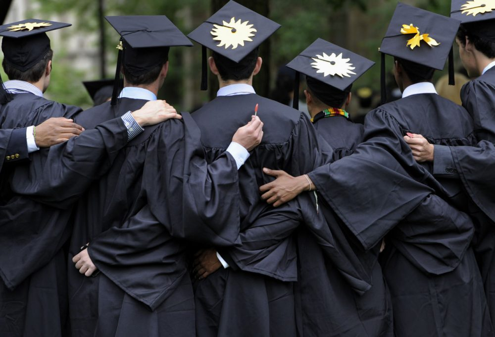 In this May 20, 2013 photo, graduates pose for photographs during commencement at Yale University in New Haven, Conn. (Jessica Hill/AP)