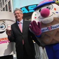 Dunkin' Brands Group President and CEO Nigel Travis, the parent company of Dunkin' Donuts and Baskin-Robbins, celebrates their initial public offering outside the NASDAQ MarketSite on July 27, 2011 in New York City.(Mario Tama/Getty Images)