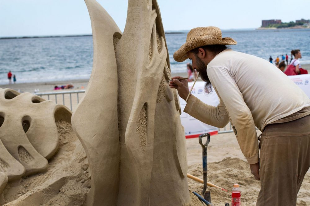 Jonathan Bouchard of Canada, who has placed first in this contest three out of the last four years, works on his sculpture. (Hadley Green for WBUR).