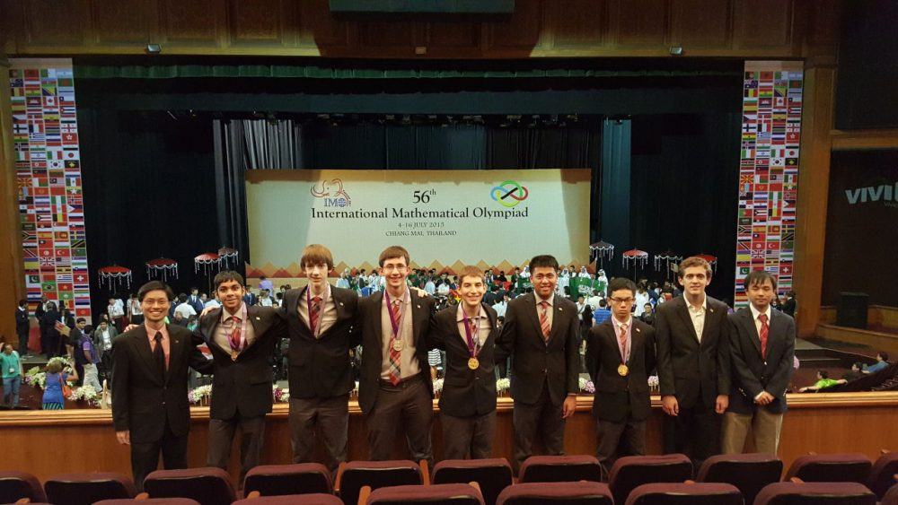 Members of the U.S. International Mathematical Olympic team, including coach Poh-Shen Loh (far left), Ryan Aleweiss (middle) and Yang Liu (fourth from right) pose with their gold medals. (Courtesy Poh-Shen Loh)