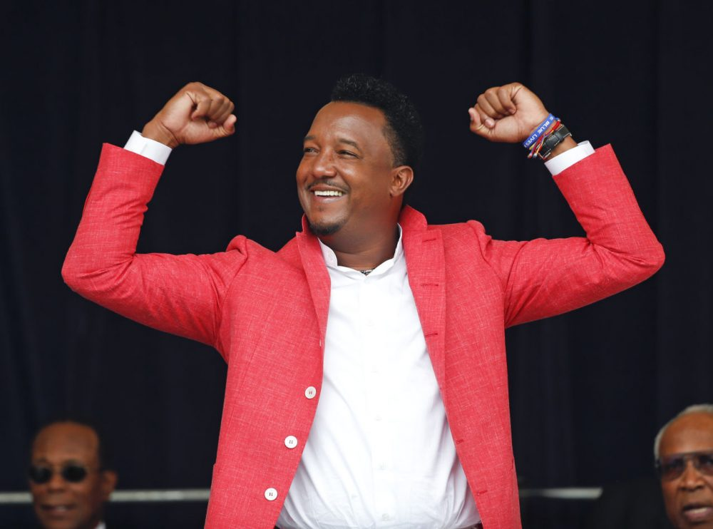 National Baseball Hall of Fame electee Pedro Martinez reacts to cheering fans during an awards ceremony at Doubleday Field on Saturday, July 25, 2015, in Cooperstown, N.Y. (Mike Groll/AP)