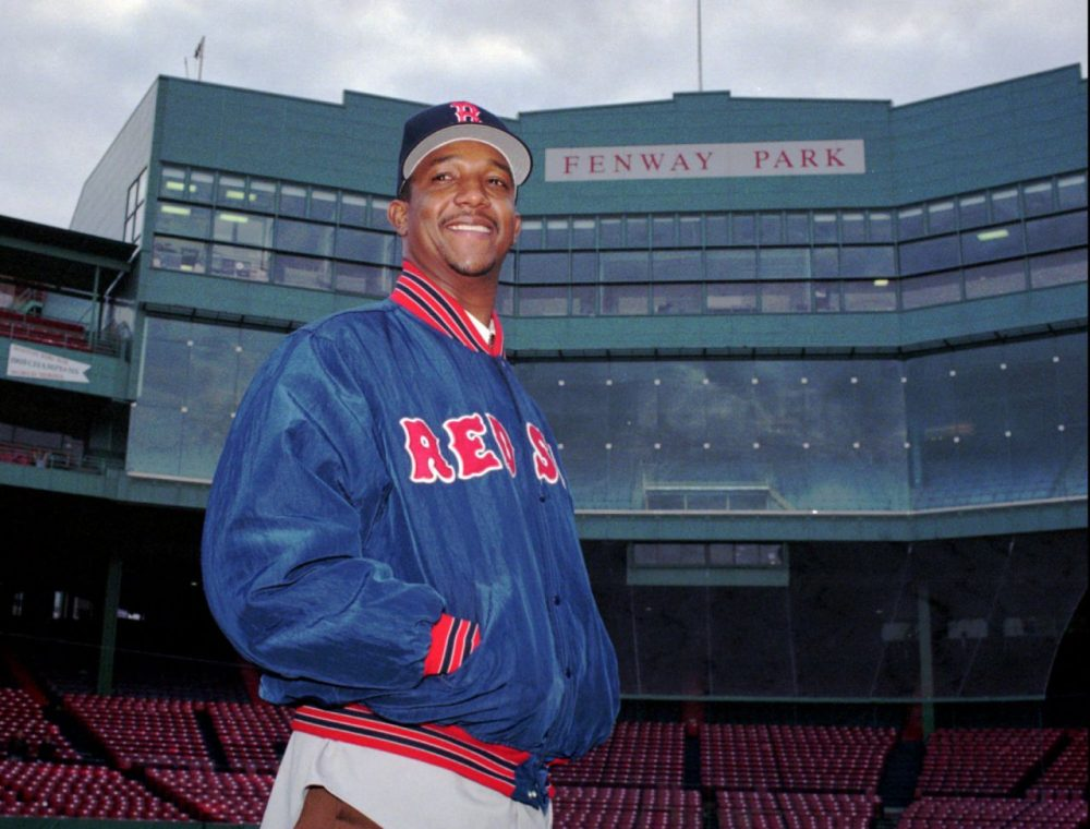 Newly acquired pitcher Pedro Martinez poses Tuesday, Nov. 25, 1997, at Fenway Park in Boston. (Julia Malakie/AP)