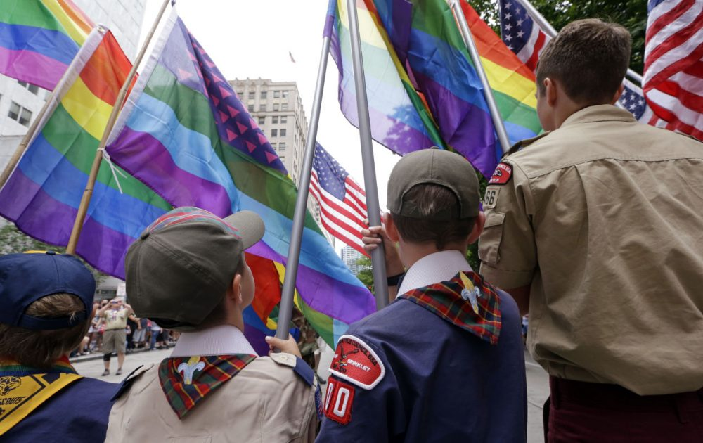 Cub Scouts and Boy Scouts prepare to lead marchers while waving flags at the 41st annual Pride Parade Sunday, June 28, 2015, in Seattle. (Elaine Thompson/AP)